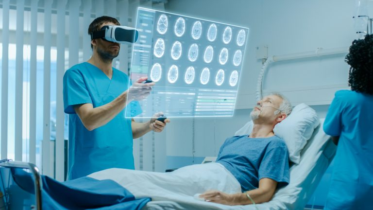Surgeon wearing a virtual reality headset and using an augmented reality interface to review a patient's brain scans and medical history