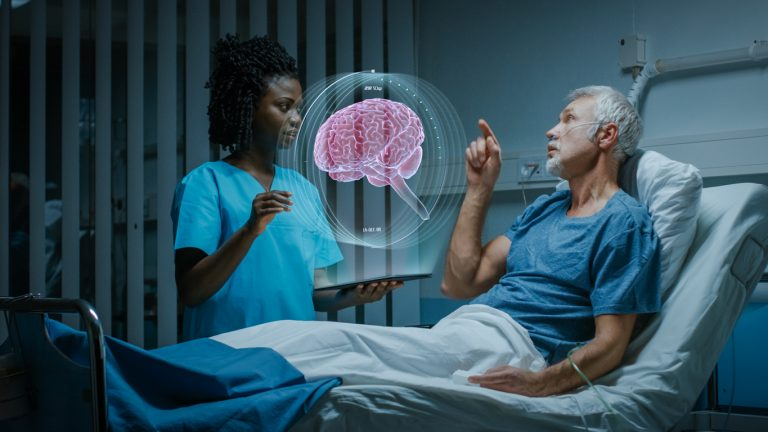 Nurse standing next to a patient in a hospital bed, with both the nurse and patient looking at an augmented reality brain scan