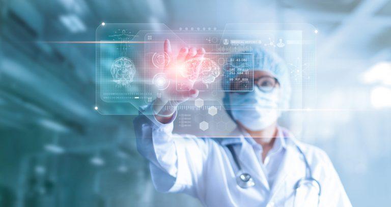 Surgeon using a 3D model to analyze a patient's brain